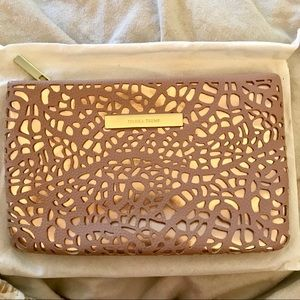 Rose gold and pink leather clutch